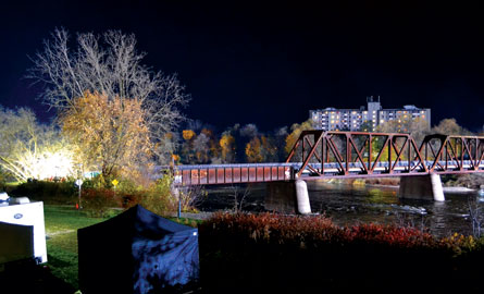 pedestrian bridge at Brant's Crossing lit up at night