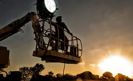 film lighting operator on a boom