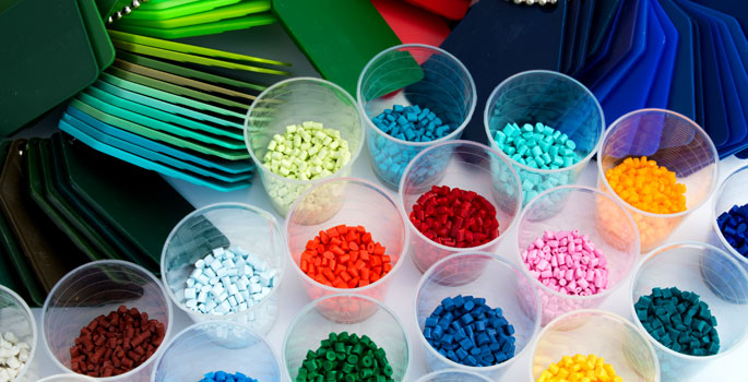 display of different coloured plastics pellet and card samples (source: http://www.istockphoto.com)