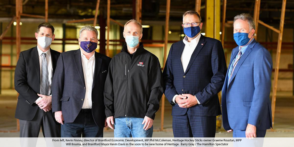 From left, Kevin Finney, director of Brantford Economic Development, MP Phil McColeman, Heritage Hockey Sticks owner Graeme Roustan, MPP Will Bouma, and Brantford Mayor Kevin Davis in the soon to be new home of Heritage.  Barry Gray / The Hamilton Spectator